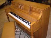 Yamaha console piano, model M2I, and bench in natural