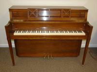 This is a handsome mahogany Yamaha console piano. It