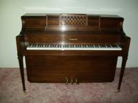 Yamaha Console/Upright Piano with a matching bench in