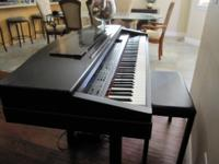 Electronic keyboard with matching bench.  A