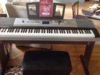 Yamaha DGX530 portable keyboard with bench and pedal.