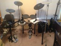 Offering a Yamaha DTX522k electronic drum set, hardly