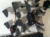 I am selling my Yamaha DTXplorer electric drumset. It