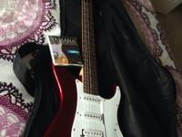 MUST GO Brand New red yamaha PAC 012 electric guitar.