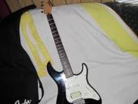 I am selling my Yamaha 4 pick-up electric guitar model