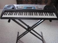 YAMAHA ELECTRIC KEYBOARD. USED VERY LITTLE. LOTS OF