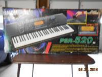 Yamaha PSR-520 Electronic Keyboard:.  This instrument