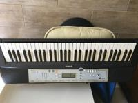 Hardly used Yamaha PSR E203 Electronic keyboard.