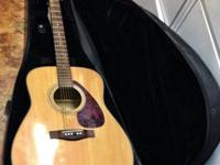The Yamaha f-325 acoustic Guitar is in great shape with