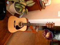 This is a Yamaha FD01S Acoustic Folk Guitar that we