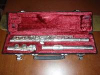 This is a Yamaha Flute Model YFL2255. Used in good