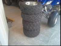 For sale is a set of yamaha raptor tires and rims. no