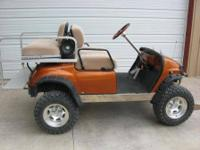 "Yamaha Gasoline Golfcart. Lifted with a 6"" heavy duty"