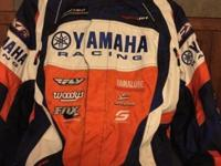 Factory Yamaha pants and jacket worn once. Both pants