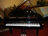 Beautiful 6ft Yamaha Grand Piano.. Like new...Polished