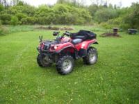 This is a Yamaha grizzly 660 4x4 with a few extras on