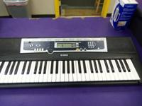 Yamaha Keyboard model YPT-210 . Please call  between