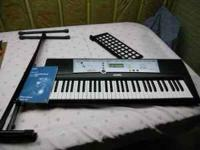 Yamaha keyboard Model YPT-200. Includes original manual