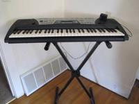 Yamaha Keyboard...Excellent condition! Stand for it, 60