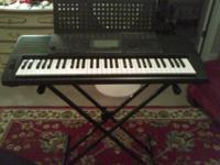 Yamaha Keyboard with music stand, keyboard stand and