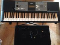 I have a Yamaha Keyboard PSR-E233. Included is a