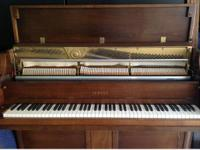 Beautiful Yamaha Console Piano Professionally