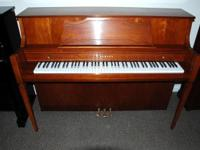 This is a very fine Yamaha console piano, model M450.