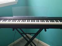 A Mint condition full 88 key weighted keyboard with