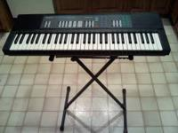 This is a nice used Yamaha electronic keyboard. It