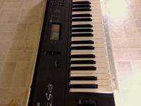 Yamaha S03 Music Synthesizer.  61 touch sensitive keys.