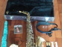 Yamaha Saxophone ready to play. Comes with a Yamaha