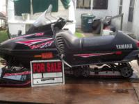 1 Yamaha snowmobile with trailer Please call or ( //