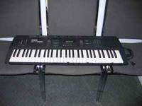 The Yamaha SY55 Music Synthesizer, features a