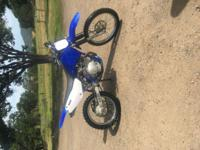 Nice dirt bike! Newer tires, new seat and very little