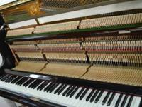 This is a beautiful Yamaha U1 Upright Piano, it has