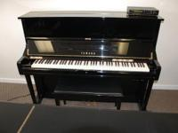 This is a wonderful Yamaha U1 studio piano with a