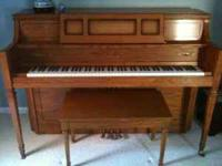 Yamaha Upright Piano - Model M402, medium oak finish.