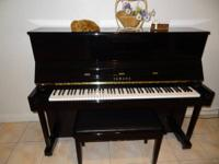 In very good condition, lightly used Yamaha Upright