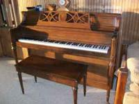 Beautiful Yamaha upright piano in excellent condition.