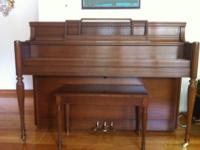 This beautiful mahogany piano was made in Japan in