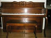 Yamaha upright piano model M215 cherry. Excellent shape