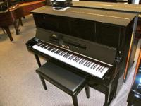 This is a Yamaha UX1 studio upright piano. 48 in