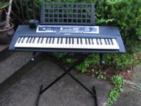Yamaha YPT210 61 Key Portable Keyboard has stand and