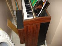 Yamaha organ and bench.Has sheet music. Asking $150.00