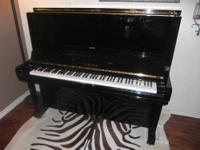 "This is a Yamaha Portable Grand Piano on stand ""DGX-530"