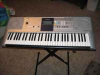 Yamaha PSR-E323 Digital Keyboard with stand, headphones