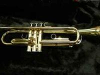 This is a Yamaha model YTR2320 trumpet, made in Japan.