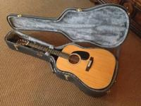 This is a very early 1970's Yamaki AY331A Steel String