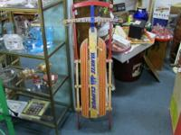 Lovely mid-century sled with steering. Measures