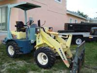 YANMAR WHEEL LOADER. DIESEL MOTOR. MACHINE HAS 850